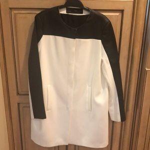Zara Black and white knee length jacket.